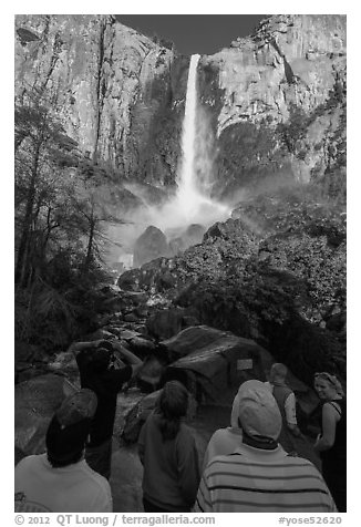 Tourists standing below Bridalvail Fall. Yosemite National Park (black and white)