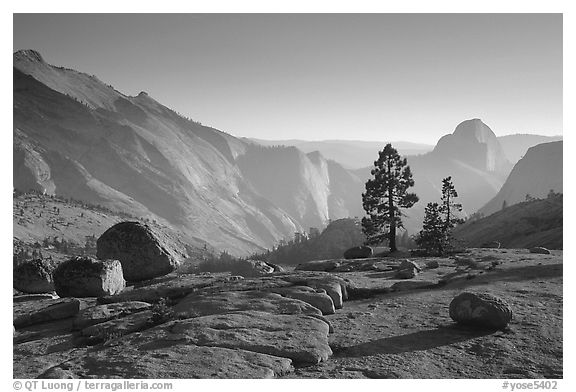 Erratic boulders, pines, Clouds rest and Half-Dome from Olmstedt Point, late afternoon. Yosemite National Park (black and white)