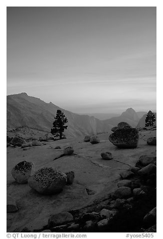 Glacial erratics, pine trees, Clouds rest and Half-Dome from Olmstedt Point, sunset. Yosemite National Park (black and white)