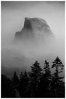 Half-Dome emerging from smoke at night. Yosemite National Park ( black and white)