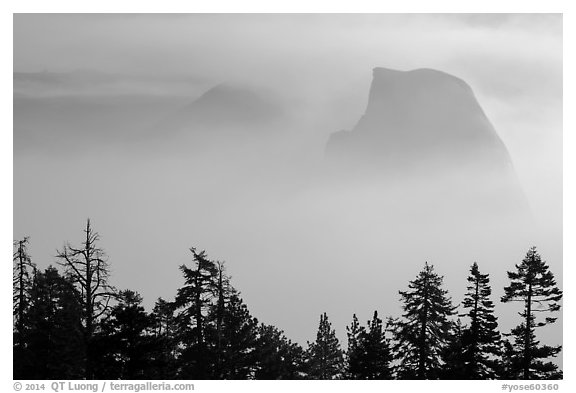 Half-Dome and Clouds Rest emerging from smoke. Yosemite National Park (black and white)