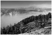 View from Sentinel Dome over fog-filed Valley. Yosemite National Park ( black and white)
