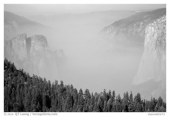 Smoky Yosemite Valley framed by Cathedral Rocks and El Capitan. Yosemite National Park (black and white)