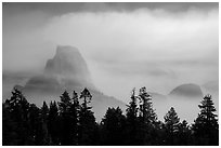 Half-Dome, clearing smoke. Yosemite National Park ( black and white)
