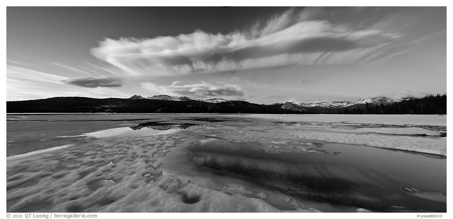 Snow-covered Twolumne Meadows and big cloud at sunset. Yosemite National Park (black and white)