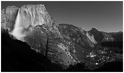 Upper Yosemite Fall with moonbow, Yosemite Village, and Half-Dome. Yosemite National Park, California, USA. (black and white)
