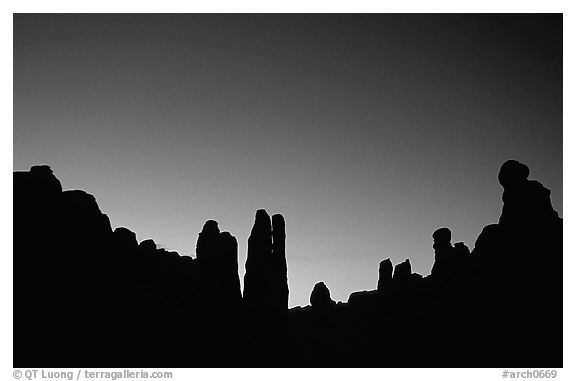Sandstone pillars in Klondike Bluffs seen as silhouettes at dusk. Arches National Park (black and white)