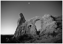 Turret Arch and moon, dawn. Arches National Park, Utah, USA. (black and white)