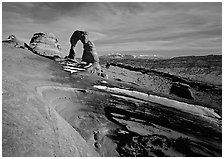 Sandstone bowl, Delicate Arch, and La Sal Mountains with snow, sunset. Arches National Park ( black and white)
