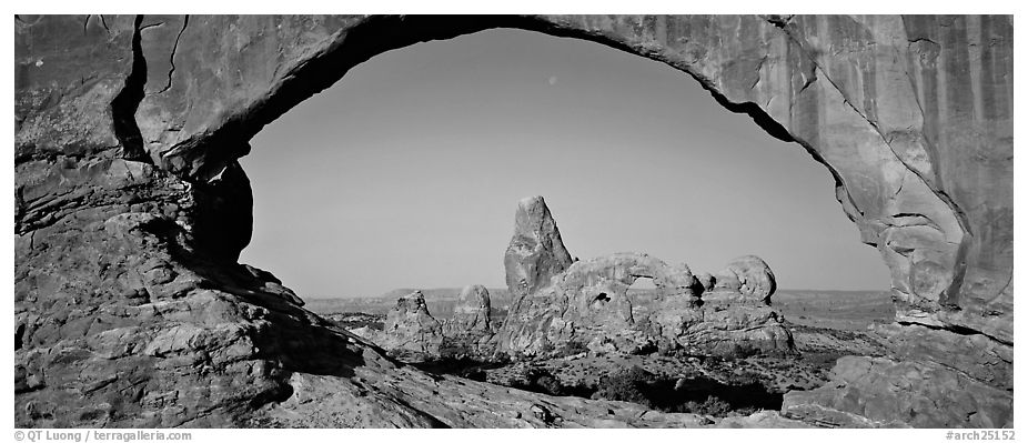 Turret Arch through slickrock window. Arches National Park (black and white)