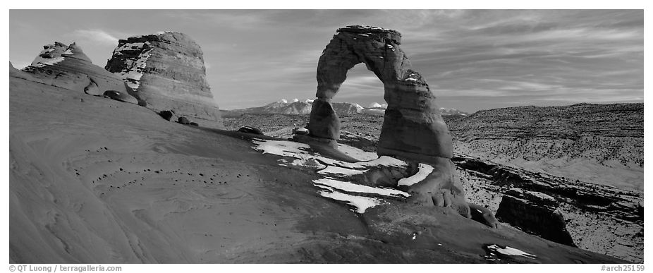Desert Arch and mountains at sunset. Arches National Park (black and white)