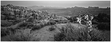 Fiery Furnace sandstone fins and mountains at dusk. Arches National Park (Panoramic black and white)