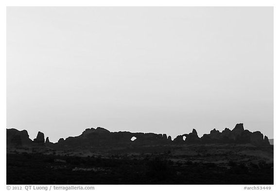 Windows Group backlit at sunrise. Arches National Park (black and white)