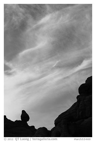 Sunset clouds and small balanced rock. Arches National Park (black and white)