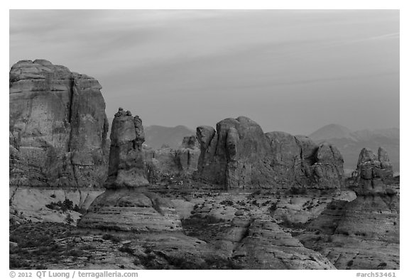 Entrada Sandstone towers seen from Garden of Eden at sunset. Arches National Park (black and white)