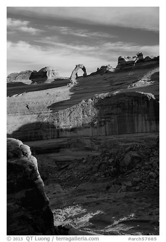 Delicate Arch atop steep cliff. Arches National Park (black and white)