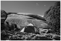 Tent with prayer flags amongst sandstone rocks. Arches National Park ( black and white)