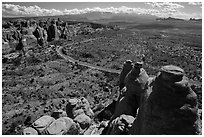 Scenic road seen from top of fin. Arches National Park, Utah, USA. (black and white)