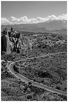 Scenic road, Fiery Furnace, and La Sal mountains. Arches National Park, Utah, USA. (black and white)