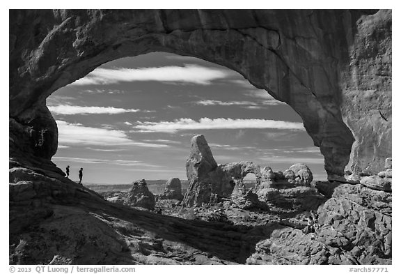Family in the North Window span. Arches National Park (black and white)