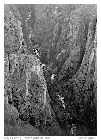 View down steep rock walls and narrow chasm. Black Canyon of the Gunnison National Park, Colorado, USA.