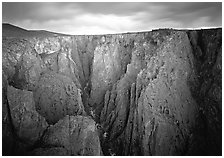 Narrow gorge under dark clouds. Black Canyon of the Gunnison National Park ( black and white)