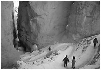Hikers descending trail in Wall Street Gorge. Bryce Canyon National Park, Utah, USA. (black and white)