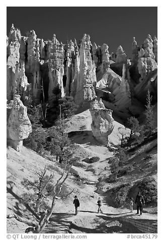 Hiker at the base of hoodoos. Bryce Canyon National Park (black and white)