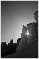 Sun star between hoodoos. Bryce Canyon National Park ( black and white)