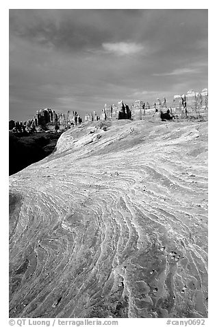 Sandstone striations and Needles near Elephant Hill, sunrise. Canyonlands National Park (black and white)