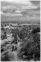 Hikers on the Chesler Park trail, the Needles. Canyonlands National Park ( black and white)