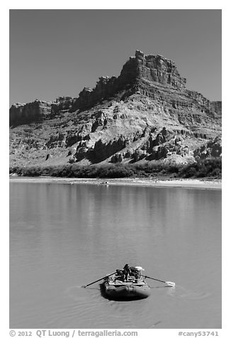 Woman paddling raft on Colorado River. Canyonlands National Park (black and white)