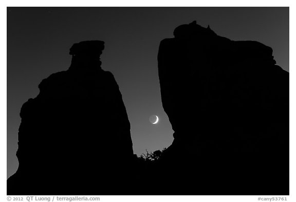 Crescent moon framed by Dollhouse spires. Canyonlands National Park (black and white)