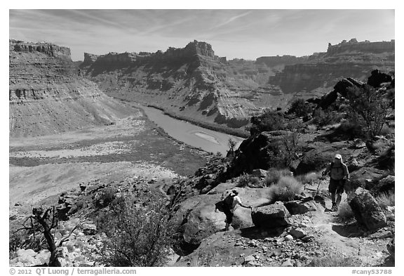 Hikers on steep trail to Dollhouse from Spanish Bottom. Canyonlands National Park (black and white)