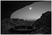 False Kiva and moon at night. Canyonlands National Park, Utah, USA. (black and white)