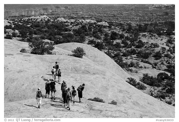 Hikers on Whale Rock. Canyonlands National Park (black and white)