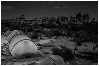 Tents at night in the Dollhouse. Canyonlands National Park, Utah, USA. (black and white)