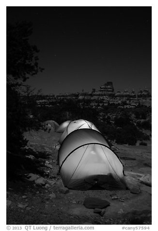 Lit tents at night in the Dollhouse. Canyonlands National Park (black and white)