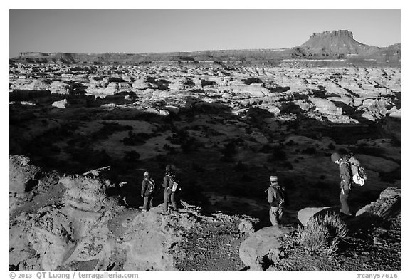 Hikers on Petes Mesa ridge above the Maze. Canyonlands National Park (black and white)