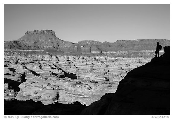 Hiker silhouette above the Maze and Chocolate drops. Canyonlands National Park (black and white)
