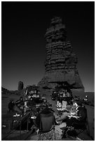 Car-camping at the base of Standing Rock at night. Canyonlands National Park, Utah, USA. (black and white)