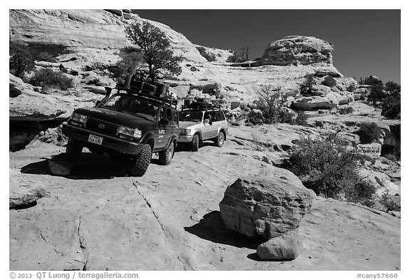 Vehicles on ledge in Teapot Canyon. Canyonlands National Park (black and white)