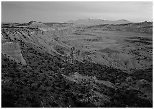 Waterpocket fold and snowy mountains at dusk. Capitol Reef National Park ( black and white)