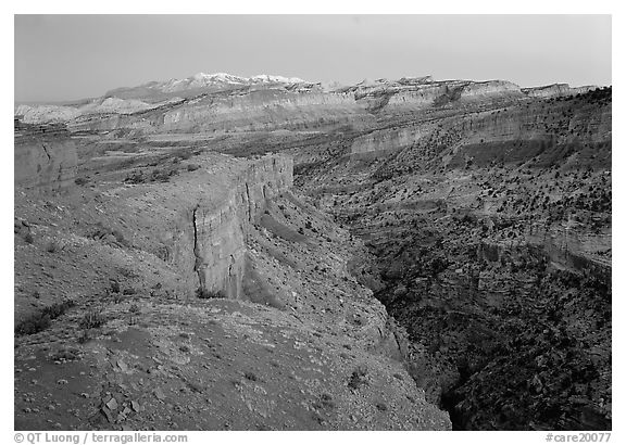 Waterpocket Fold and snowy mountains at dusk. Capitol Reef National Park (black and white)