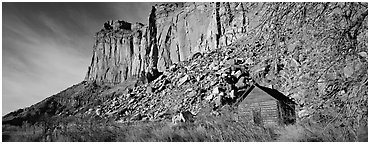 Fruita pioneer school house at the base of sandstone cliffs. Capitol Reef National Park (Panoramic black and white)