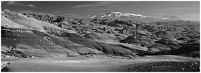 Mudstone landscape and snowy mountains, Cathedral Valley. Capitol Reef National Park (Panoramic black and white)