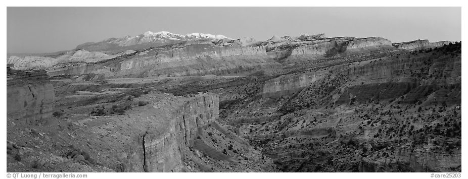 Panorama of multi-hued cliffs and Henry Mountains at dusk. Capitol Reef National Park (black and white)