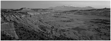 Desert view with cliffs and mountains at dusk. Capitol Reef National Park (Panoramic black and white)