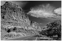 Rood, cliffs, and orchard in autumn. Capitol Reef National Park, Utah, USA. (black and white)