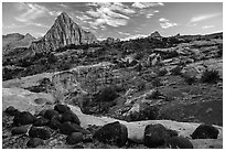 Black volcanic boulders and Pectol Pyramid. Capitol Reef National Park, Utah, USA. (black and white)